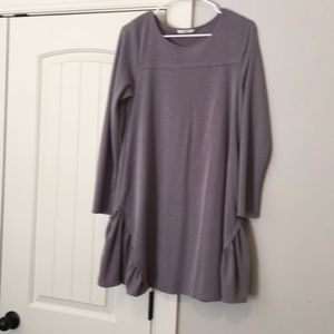 NWOT dress with ruffle detail at the bottom.